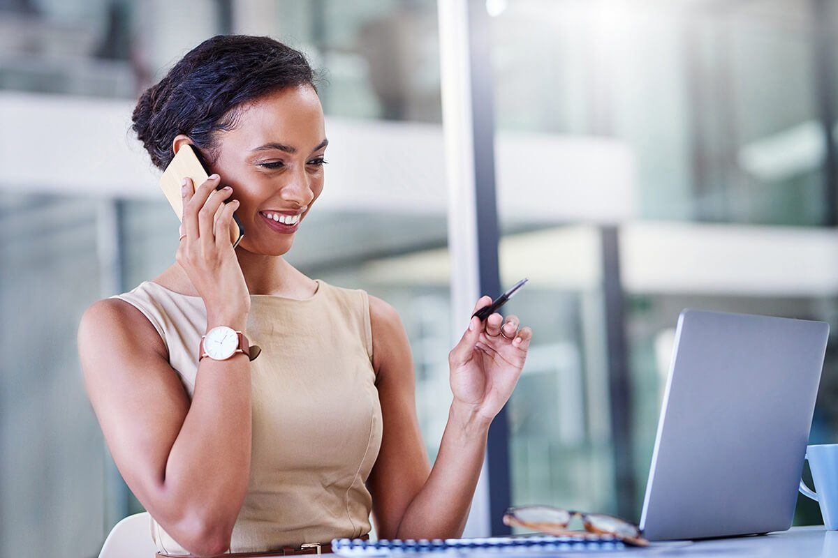 Cheerful business woman on phone