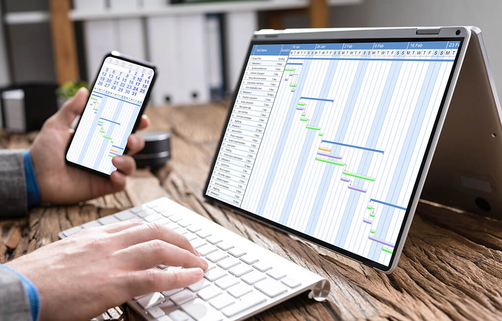 timeline schedule on laptop and phone